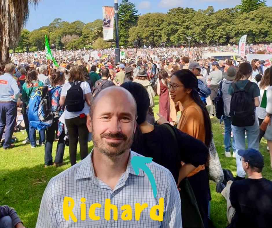 A picture of Richard, a male Hume employee, surrounded by people at a protest.